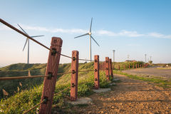 Walk way to power generation wind turbine Stock Photo