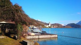 Walk by Wolfgangsee lake, St Wolfgang, Austria stock footage