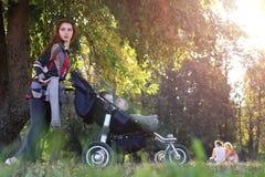 Walk women with stroller summer sunlight Stock Photos