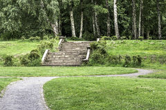 Walk In The Woods. An image of a pathway toward steps leading into the Woods Royalty Free Stock Photos