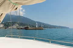 Walk on a yacht on the Black sea of the Crimea. Lighthouse in Yalta Royalty Free Stock Photo