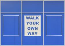 Walk Your Own Way. Text Walk Your Own Way written on blue background royalty free stock photography