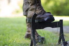 A walker cleaning the soles of walking boots Stock Photo