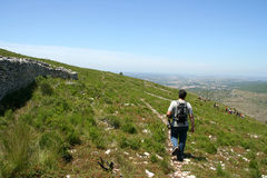 Walker down the mountain Royalty Free Stock Photography