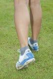 Walker's Feet closeup on wet grass royalty free stock image