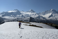 Walker in the snow. With the massif of Mont Blanc in background Royalty Free Stock Photos