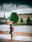 Walker in Stockholm on rainy day Stock Photo