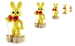 The Walkers. Yellow plastic bunnies in bast shoes Royalty Free Stock Photo