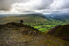 Walkers admiring the view over Keswick Royalty Free Stock Image
