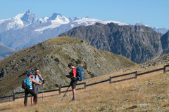 Walkers in a beautiful mountain landscape Royalty Free Stock Images