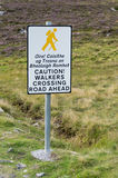 Walkers Crossing Sign. In the middle of Connemara park, Ireland. The written are also in gaelic Stock Photos
