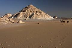Walkers in desert Royalty Free Stock Photo