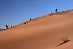 Walkers in a desert landscape Stock Image