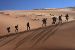 Walkers on the dune Stock Images