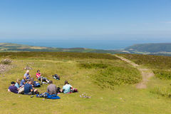 Walkers enjoying a rest in the beautiful summer weather having climbed to the top of Dunkery Beacon Somerset Royalty Free Stock Photography