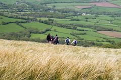 Walkers on the hill. Group of young people on a hike, Brecon Beacon, Wales, UK Royalty Free Stock Images