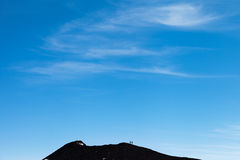Walkers on mount Etna, Sicily. Royalty Free Stock Image