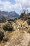 Walkers at Polyrenia, Crete, Greece. Couple on path returning from acropolis atop mountain at Polyrinia, Polyrenia, Crete, Greece Royalty Free Stock Photography