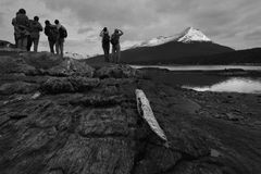 Walkers on the shore of Beagle Channel Stock Photos