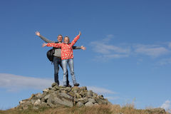 Walkers Standing On Pile Of Rocks stock image