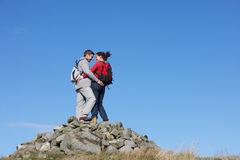 Walkers Standing On Pile Of Rocks Royalty Free Stock Photography