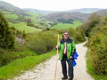 Walkers of the Way of Saint James. A couple of walkers in the way of Santiago de Compostela saint james travel pilgrimage spain symbol route trekking shell arrow royalty free stock photo