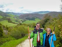 Walkers of the Way of Saint James. A couple of walkers in the way of Santiago de Compostela saint james travel pilgrimage spain symbol route trekking shell arrow royalty free stock images