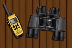 Walkie-talkie and binoculars. On a wooden table. Vector illustration Royalty Free Stock Image