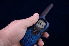 Walkie-talkie in hand Royalty Free Stock Images