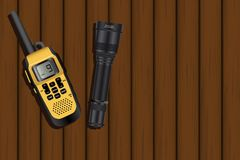 Walkie-talkie and a lantern. On a wooden table. Vector illustration Stock Photos