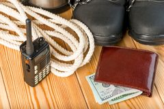 Walkie-talkie, rope, shoes and some money for a dangerous winter. Hike - close-up objects Royalty Free Stock Images