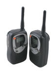 Walkie-talkies. A pair of small walkie-talkie radios isolated on white background with clipping path Stock Image