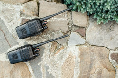 Walkie Talkies on stones background outside. Concept of Wireless Communications. Royalty Free Stock Images