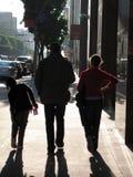 Walking. Family walking down a city street Stock Image