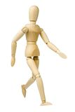 Walking. Wooden model dummy in walking position. Isolated on a white background stock images