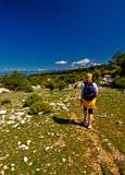 Walking. Woman walking in the forest of island krk in croatia on sunny day Royalty Free Stock Image