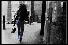 Walking. Young woman walking stock photo