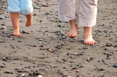 Walking. Feet walking on beach Royalty Free Stock Photography