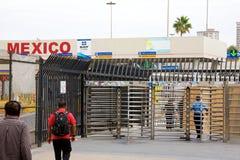 Walking across the border Stock Photo