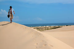 Walking across the sand dunes Stock Image