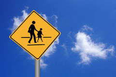 Walking across the street signs. Against blue sky Stock Image