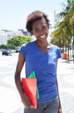 Walking african american student in the city Royalty Free Stock Images