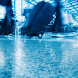 Walking airport passenger with motion blur. Passengers walking in the airport terminal Royalty Free Stock Images