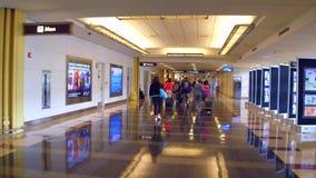 Walking through an airport stock footage