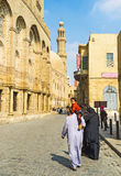 Walking in Al-Muizz street. CAIRO, EGYPT - OCTOBER 12, 2014: The Al-Muizz street is the open air islamic museum, famous among the locals and tourists, on October Royalty Free Stock Photo