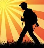 Walking all day long. Hiker (backpacker) silhouette walking until sunset Stock Image