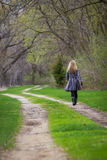 Walking alone Royalty Free Stock Photo