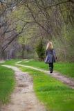 Walking alone Royalty Free Stock Photo