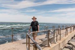 Walking along Barnegat Inlet. Man walking along Barnegat Inlet at Long Beach Island, NJ, USA Royalty Free Stock Photography