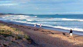 Walking along beach Stock Photo
